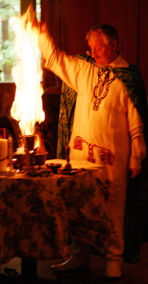 Isaac Bonewits standing at altar with flames rising 2008